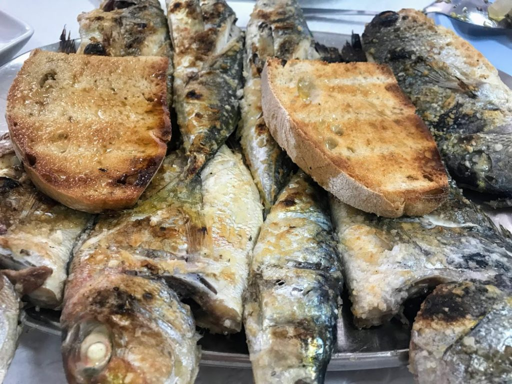 Sardines and bread with olive oil