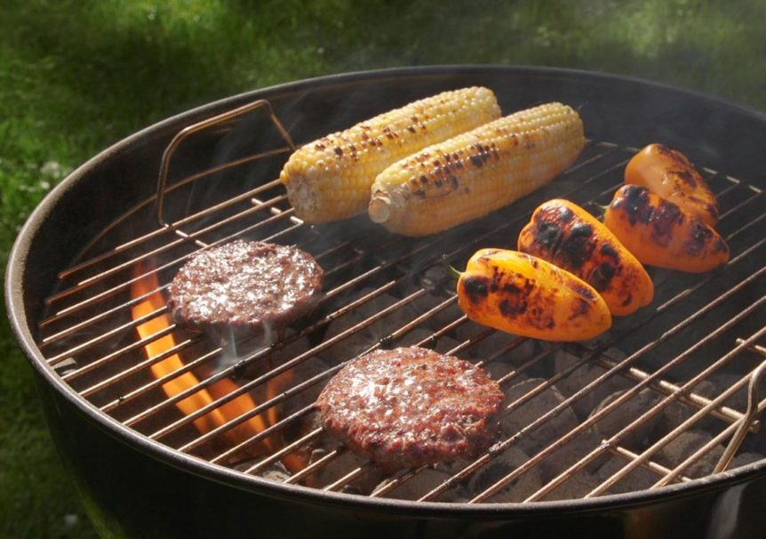 burgers and vegetables in the charcoal grill