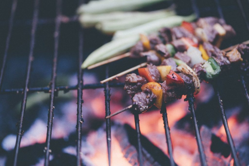 Grilling with kids. Grilled veggies on skewers