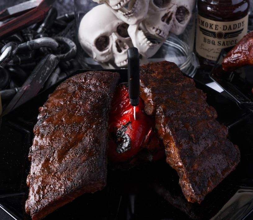 In this BBQ ideas for your Halloween party we see a dead man chest made with smoked ribs